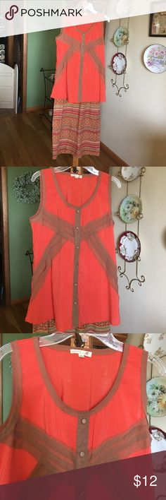 "Mine sleeveless blouse with brown trim! Mine orange sleeveless blouse with brown trim, has decorative buttons down front. Brown trim criss crosses the front! Beautiful flowing for summer! Armpit to armpit is 18"" Mine Tops Tank Tops"