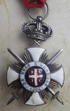 Serbian Order of the Star of Karageorge with Swords, Serbia - Europeana 1914-1918 CC-BY-SA https://en.wikipedia.org/wiki/Order_of_Kara%C4%91or%C4%91e%27s_Star