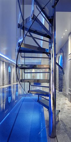 Gorgeous contemporary design with a stunning spiral stair focal point by Portrait Pools of United Kingdom.