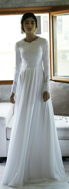 Timeless modest wedding gown with long sleeves. Sol. Studio Levana