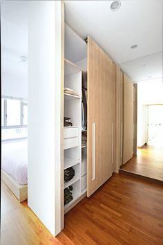 Using the wardrobe as a room divider instantly creates a more private dressing area.