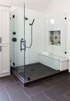 BEFORE AND AFTER - Master bathroom remodel, new shower with cement look tile sha. BEFORE AND AFTER – Master bathroom remodel, new shower with cement look tile shampoo niche, white subway tile with dark grout, bench and black plumbing fixtures