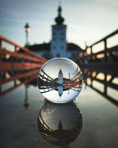 A nice clear reflection shining down on a puddle through a lensball captured by Glass Photography, Reflection Photography, Photography Lessons, Macro Photography, Creative Photography, Digital Photography, Amazing Photography, Landscape Photography, Photography Ideas