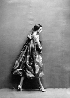 Carmen in Cardin's sacque coat of rose brocade, falling stiffly from a wide-away collar © Richard Avedon for Harper's Bazaar, Oct. 1957.