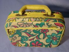 Retro 1960s 70s Psychedelic Flowers Small Childs Suitcase.  Mine had magic marker stains all in it.