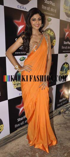 http://www.kalkifashion.com/ Shilpa Shetty poses in an orange Gaurav Gupta saree on the set of Nach Baliye