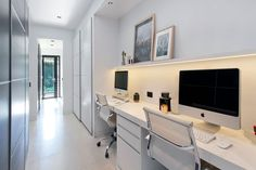 With enough room for two, this large desk sits below a small floating shelf with hidden lighting, while the long white hallway provides the perfect space for a tucked-away home office. Study Room Design, Study Nook, Office Space Design, Small Room Design, Home Office Space, Home Office Decor, Home Decor, Study Space, Office Ideas