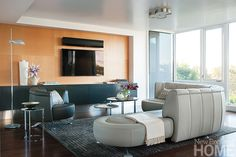 The living room's low ceiling gets a visual lift from Venetian plaster, while a shallow soffit around the perimeter disguises utility wires.