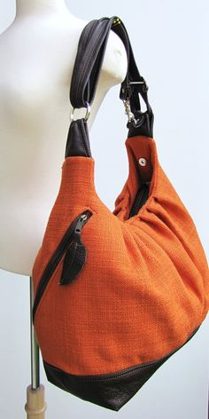 Extra large orange canvas convertible backpack, messenger, tote, diaper bag with leather straps, base, and zipper top closure