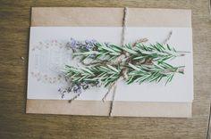 Sprigs of rosemary and lavender tied around menu card