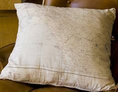 Airplane room.  Accent with map pillow.  Print map of where child was born.