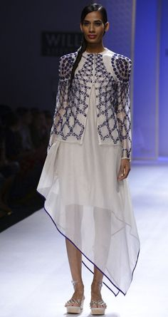 Ivory and blue embroidered jacket by RAHUL MISHRA. http://www.perniaspopupshop.com/wills-fashion-week/rahul-mishra #fashionweek #willslifestyleindiafashionweek