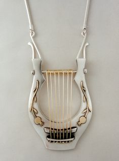 Lyre Pendant by Ahlene Welsh, 1997. Sterling silver and 14k gold