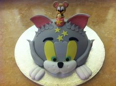 Tom and Jerry~~Wesley would love this! However, we tried last year, and it's very difficult to find reasonably priced Tom and Jerry Birthday party supplies.