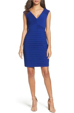 Perfect for any occasion, this flattering classic pleated sheath dress is guaranteed to keep you looking chic
