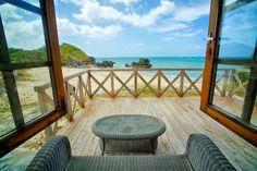 A view of the ocean from an Okuma Beach Resort Ai Beach Cottage porch