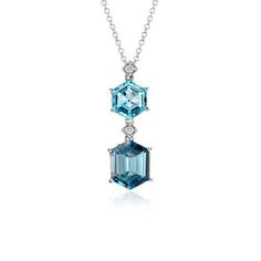 Truly sparkling, this gemstone pendant features a unique hexagon shape blue topaz and london blue topaz with pavé diamond accents framed in 14k white gold.