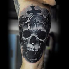 Guys Ankles Black And White Cross And Skull Tattoo