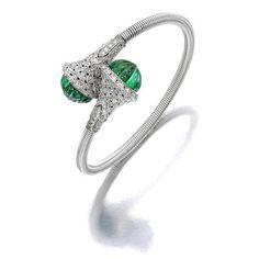 An emerald and diamond bangle