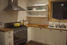 Ikea Adel White  with square bin pulls Kitchen Remodel by apronless, Close to our kitchen