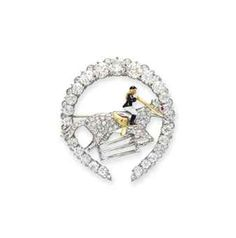 AN ART DECO DIAMOND AND ENAMEL HORSESHOE BROOCH | brooch, diamond | Christie's