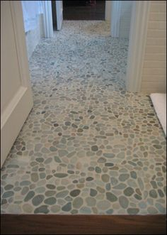 Pebbled tile is perfect for a luxury spa feel in the bathroom or shower. …