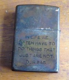 "army-issued Zippo - Vietnam War - ""In life we often have to things that just are not our bag."""