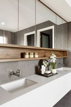 A bathroom doesn't have to be a clinical space. It should be a room to relax and linger in. Select good quality tiles and keep the colours neutral and then you can add some great finishing touches to make the bathroom a beautiful room. I have 5 top tips to help you achieve this in my post on Bathroom Styling.