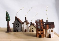 Miniature felt houses with tree, Home decor. Textil art.  Miniature of five lovely cottages in earth tones and one tree. Made of felt, treated to get some rigidity.  The measures range from 5 (13 cm) of tree height and 2 (5.5 cm) of the smaller house.  Play and build your small village.:)