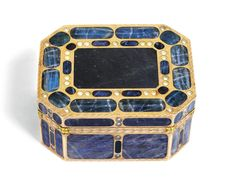 A RARE TWO-COLOUR GOLD AND HARDSTONE SNUFF BOX, WORKSHOPS OF JOHANN CHRISTIAN NEUBER, DRESDEN, CIRCA 1780 of rectangular form with cut corners, inlaid with panels of polished labradorite ornamented with smooth simulated pearls, the borders engraved with laurel, applied yellow gold leaves at the corners, unmarked, later French import marks  gold and hardstone  width 7.6cm, 3in