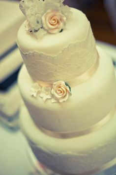 I love the lace! Do navy ribbons & fresh coral roses or other flowers!! Pretty & elegant. Maybe too pretty little girl for my taste?