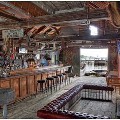 man cave. Get some ideas from this for your man cave at home. Looks like a cool place to hang out...
