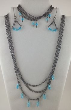 Sooooo simple to make!  The chain is a preformed gunmetal colored chain, made bead attachments with e-beads and small turquoise beads, and formed the earring hoops myself using simple 20 gauge wire and a ring sizer.  (All materials were bought at Michaels)