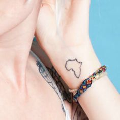 small Africa continent tattoo