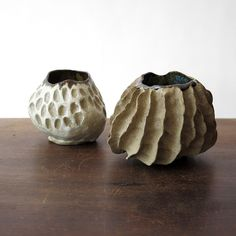 """organically formed ceramic vessel with raw exterior. variegated interior glaze features tones of turquoise, green, and pewter. about 3.5"""" tall and 4.5"""" around. made by multimedia artist hardie cobbs i"""