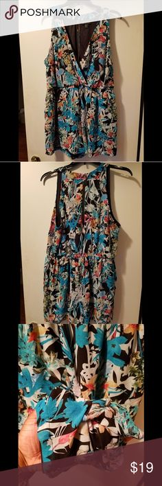 FOREVER 21 Sleeveless  Floral Print Romper This pre-worned Forever 21 floral print romper is a fresh take on one of your favorites!   Gently Used- worn once Size- 3X  Styled by Elle- I paired this romper with a coral lace duster and cognac colored gladiator sandals. Forever 21 Dresses Mini