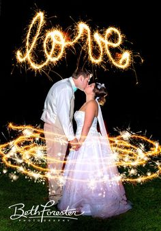 bride and groom at night with sparklers | long exposure wedding shot | Love sparklers