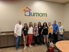ACI Phoenix team participates in Read to Me event at UMOM New Day Center, where volunteers read to resident children.