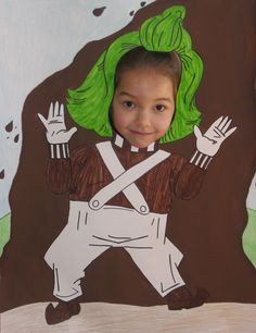 My daughter at the oompa loompa photo shot activity.  I found this online and made one of my own with a 50 cent poster board from the dollar store and markers and paint I had at home.