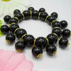Try this with chains of smaller pearls hanging between the larger pearls