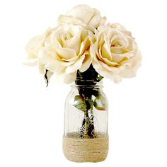 Create a lush tablescape or charming vignette with this lovely faux rose arrangement, featuring vanilla-hued blossoms nestled in a mason jar-inspired vase wi...