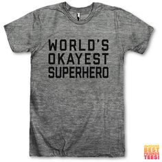 World's Okayest Superhero ($28) ❤ liked on Polyvore featuring tops, t-shirts, black, women's clothing, loose fit t shirts, drapey tee, t shirts, unisex t shirts and loose tee