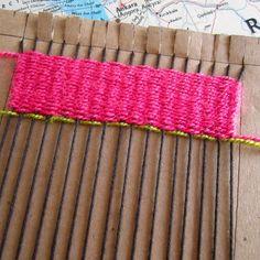kids weaving on cardboard loom