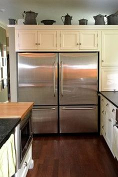 Wyncote home - traditional kitchen---- two separate refrigerators with opposite handles neat idea