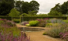 planting and fountain in summer at Scampston Hall Walled Garden at North Yorkshire, by Piet Oudolf (photo by celiamaughan, via Flickr)