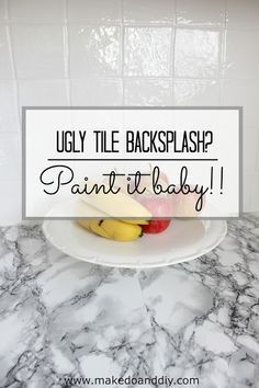 painted tile backsplash-cover those ugly tiles! www.makedoanddiy.com