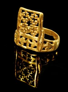 Roman Gold Ring With Crosses and Ivy Leaves, 3rd-4th Century AD( you can see the ring better in its reflection)