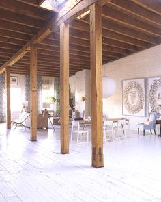 The pine floors and brick walls of this loft were coated with white paint to brighten a space dominated by wooden columns and beams that are original to the structure. Loft House, My House, Lofts, My Home Design, House Design, Wooden Columns, Loft Spaces, Studio Spaces, White Rooms