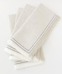 HANDMADE by maeree Organic Linen Napkins. Luxurious oatmeal linen is finished with contrasting ebony stitching and frayed edges. Rustically chic.