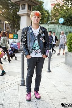 December 2014: Toshitaka is wearing a biker jacket from Eagle Leather that's been customized with buttons and patches – featuring both classic punk and anime/manga – as well as lots of studs. He's wearing his punk x Akihabara leather jacket over a graphic t-shirt and Topman jeans. His pink shoes are from Dr. Martens.